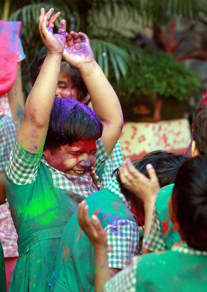 Little kids play Holi with their friends. (PTI)