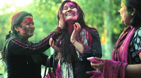 College students play Holi in the capital. (IE Photo: Amit Mehra)