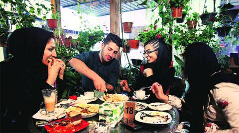 """At a cafe in Tehran. Reports of cafes being shut for violating """"Islamic dignities"""" have dropped sharply.  AP"""