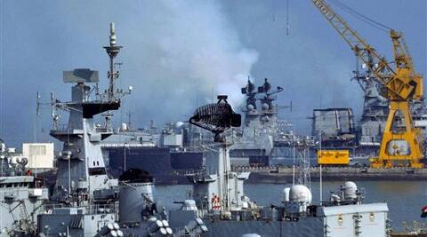 Smoke billowing out after a fire at INS Kolkata at Naval Dockyard in Mumbai on Friday. (PTI)