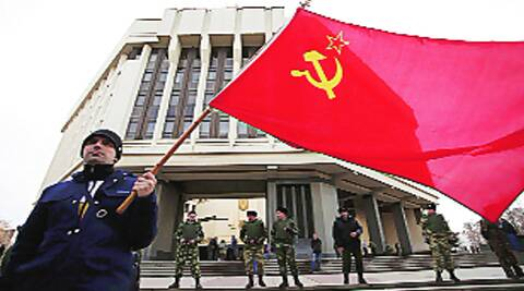 A man holds a Soviet Union flag as he attends a pro-Russian rally at the Crimean parliament building in Simferopol Thursday. reuters