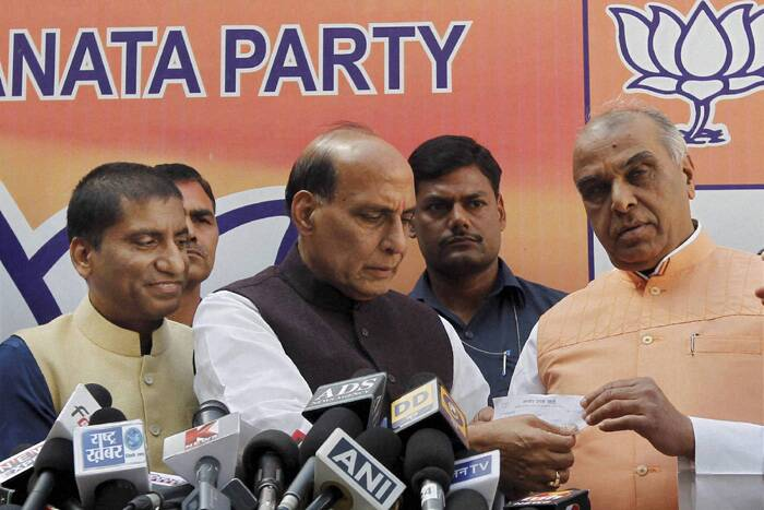 Rajnath Singh, while handing over membership slip to Pal, said he has quit his primary membership of Congress as well as the Lok Sabha seat. (PTI)
