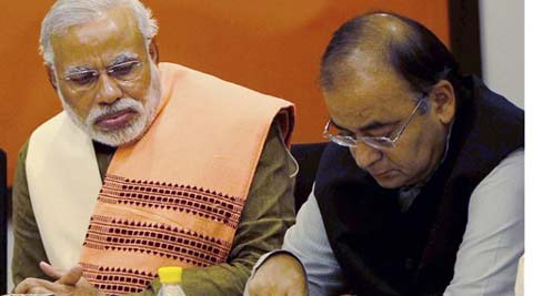 Gujarat Chief Minister and BJP's PM candidate Narendra Modi and senior leader Arun Jaitley during the party's Central Election Committee meeting at party headquarters in New Delhi. (PTI Photo)
