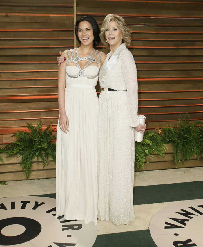 Actress Olivia Munn and Jane Fonda were serene in white. (Reuters)