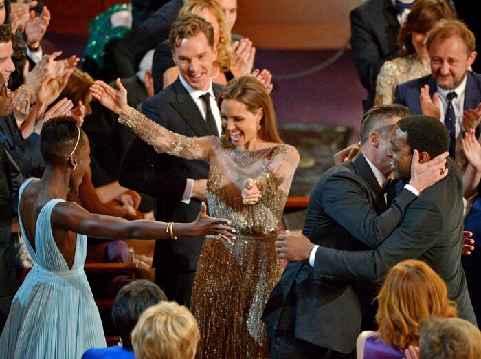 Angelina is thrilled with '12 Years a Slave' being announced as the best film. She turns to Lupita Nyong'o for a hug.