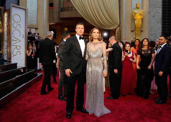 The King and Queen of Hollywood, Brad Pitt and Angelina Jolie arrived arm-in-arm. While Jolie was stunning in a sparkly number, Brad was dapper in a black tuxedo.  The actor has been nominated tonight for his role as co-producer on '12 Years A Slave'. (AP)
