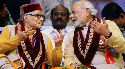Bharatiya Janata Party (BJP)'s prime ministerial candidate Narendra Modi and Senior BJP Leader Murli Manohar Joshi during the Traders National Summit in New Delhi. (PTI Photo)