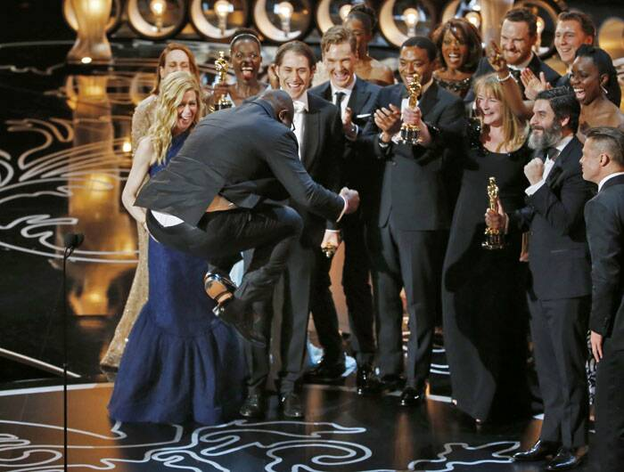 An ecstatic Steve McQueen celebrates his Oscar win along with the '12 years A Slave' team.