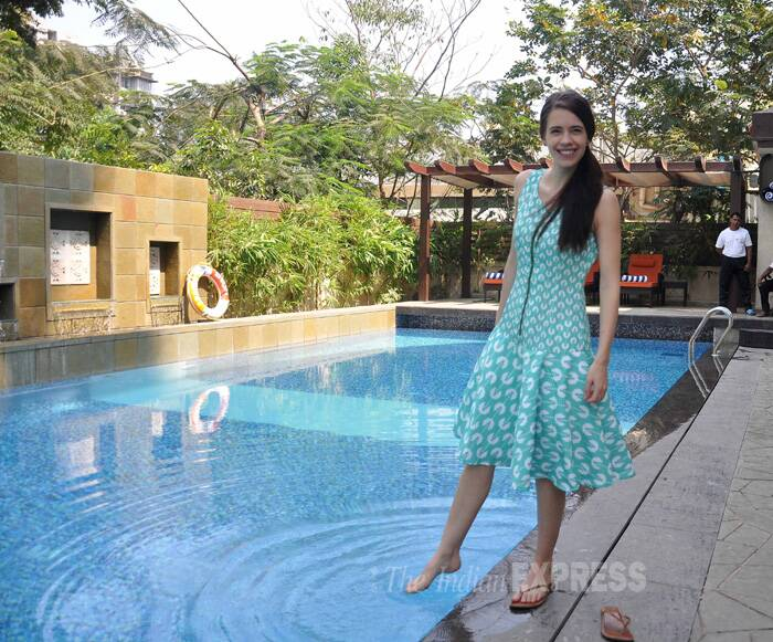 The actress cools off as she dips her toes in the pool. (Photo: Varinder Chawla)