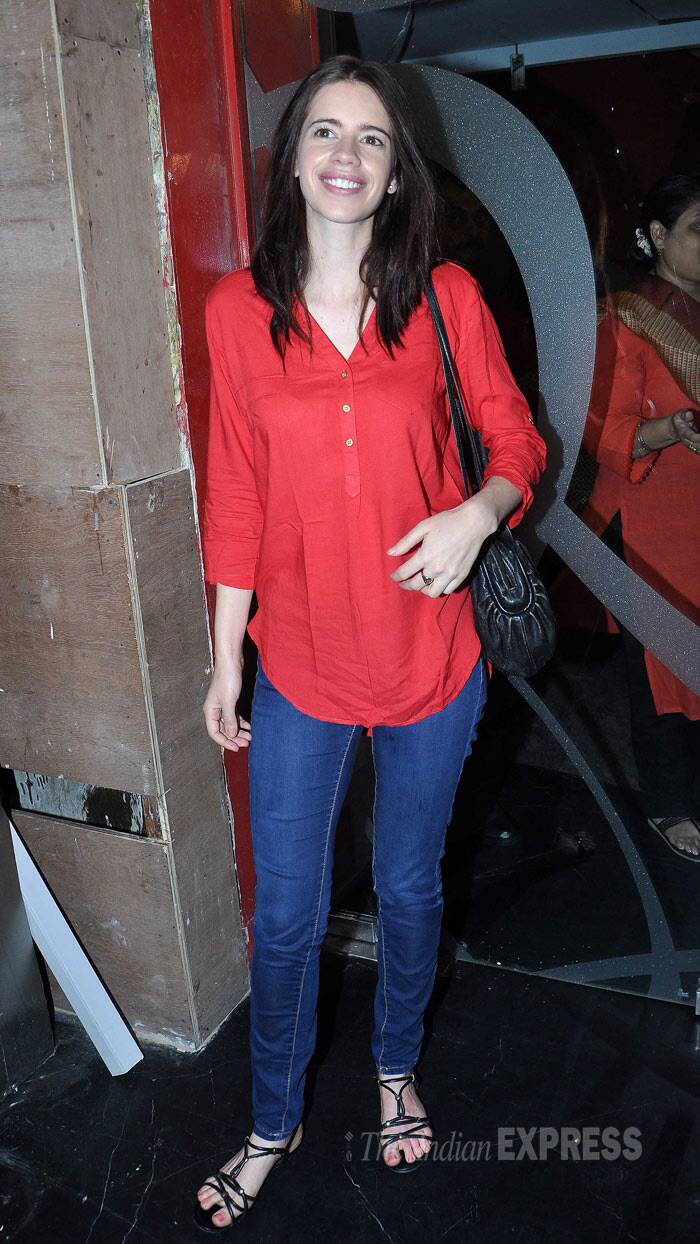 "Actress Kalki Koechlin looked happy to be solo in a bright red top with denims and strappy sandals. ""Maine 'Ankhon Dekhi'. Issiliye main keh sakti hun ke bahut achcha hai, super hai aur khoobsurat hai,"" posted the actress. (Photo: Varinder Chawla)"