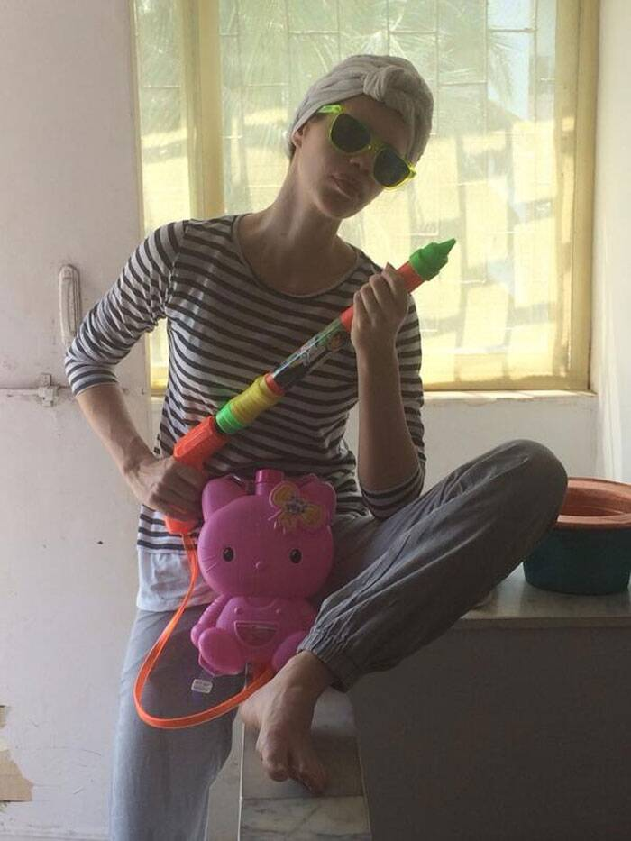 Kalki Koechlin, who has said, that she will be playing Holi like crazy, was dressed in Pyjamas and tshirt armed with a kitty pichkari and funky glares.
