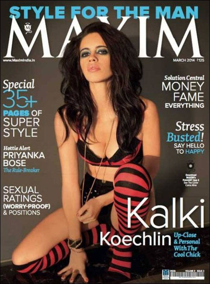 Kalki Koechlin looks ravishing, as she appears on the cover of Maxim in a red and black bra, leaving nothing to imagination. The actress shows off her legs in tiny shorts and is seen sporting a pair of matching knee-length socks. Smoky eyes and a sexy pout finish off her look!