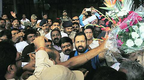 Supporters greet Kalmadi at the airport on Thursday.(Express)