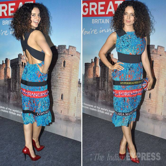 In another part of the city, Kangana Ranaut attended an app launch looking sexy in a cross back printed dress with scarlet heels. (Photo: Varinder Chawla)
