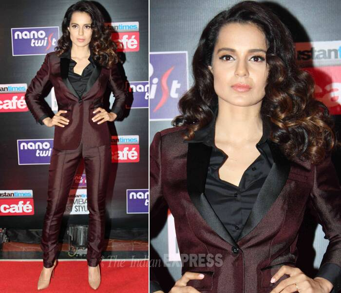 The rising fashionista of Bollywood Kangana Ranaut took a leaf out of Angelina Jolie's book. The 'Queen' actress was stylish and crisp in the maroon Burberry suit. Kangana opted for  light makeup and curls and nude pumps to finish off her look. (Photo: Varinder Chawla)