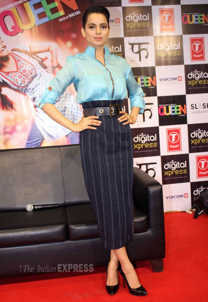 Kangana was as usual at the top of her game in the style department in a sky blue shirt with a navy striped pencil skirt and black pumps. (Photo: Varinder Chawla)