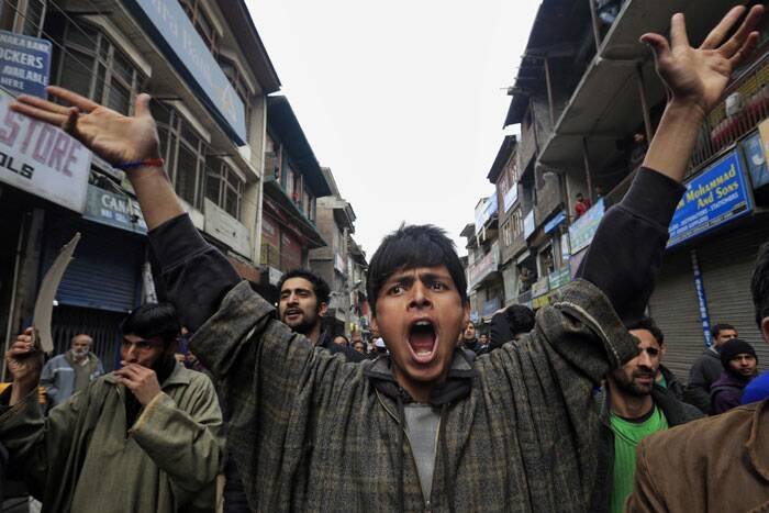 A supporter of Jammu Kashmir Liberation Front (JKLF) shout pro freedom slogans during a protest in Srinagar on Friday. Dozens of Muslim students from the disputed Indian territory of Kashmir were expelled from their university and briefly threatened with sedition charges because they cheered for the Pakistani cricket team during a televised match against archrival India, police said Thursday, while the Indian state's elected leader called for leniency. (AP)