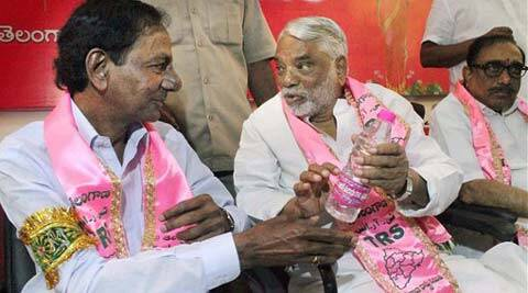 Telangana Rashtra Samithi (TRS) President K Chandrashekar Rao with party General Secretary K Keshava Rao at the party's politburo meeting in Hyderabad. (PTI Photo)