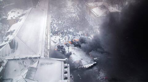 An aerial view shows pro-European protesters burning tyres during clashes with riot police. (Reuters)