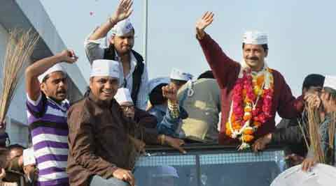 Aam Aadmi Party (AAP) chief Arvind Kejriwal waves to his supporters during his election campaign in Ahmedabad on Wednesday. (PTI)