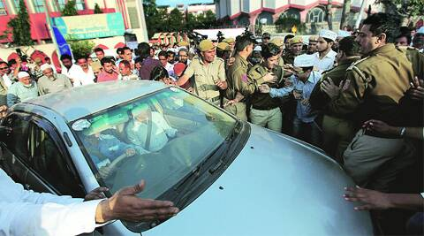Protesters try to stop Kejriwal's car on Tuesday. (Ravi Kanojia)