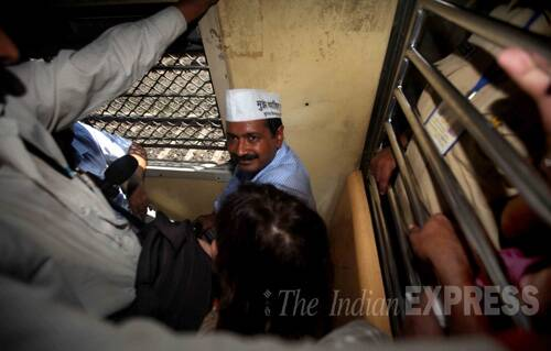 "A group of youths showed black flags to Kejriwal as he was leaving the station. They said they did not belong to any organisation but were students who were protesting against Kejriwal's alleged ""media management"" as seen in a leaked video of him on YouTube in which he appears to tell a news anchor to highlight parts of his interview. (IE Photo: Pradip Das)"