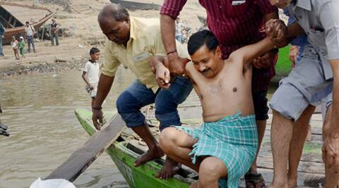 Kejriwal takes a dip in the Ganga at Rajghat in Varanasi on Tuesday. PTI