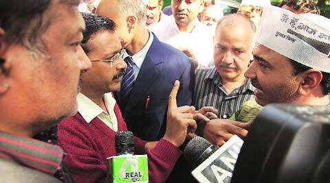 AAP workers spar with Kejriwal outside his residence on Sunday. (Gajendra Yadav)