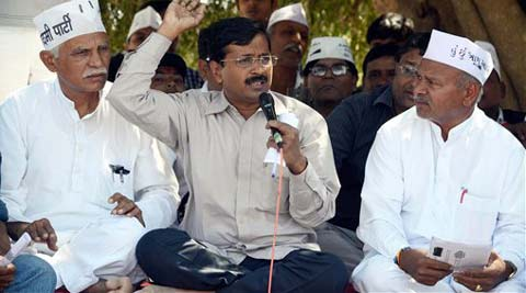 Aam Aadmi party chief and former Delhi's chief minister Arvind Kejriwal address to affected farmer of Maruti Suzuki new plant at Hansalpur in north Gujarat on Wednesday. (PTI Photo)