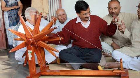 Aam Aadmi Party (AAP) convener Arvind Kejriwal trying his hands on a spinning wheel during his visit to Sabarmati Gandhi Ashram in Ahmedabad on Saturday. (PTI Photo)