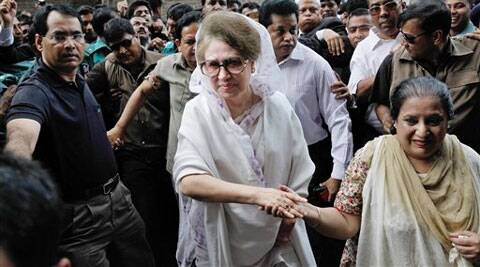 In this March 19, 2014 photo, former Bangladeshi prime minister Khaleda Zia, center, arrives to appear before a court in Dhaka. (AP)