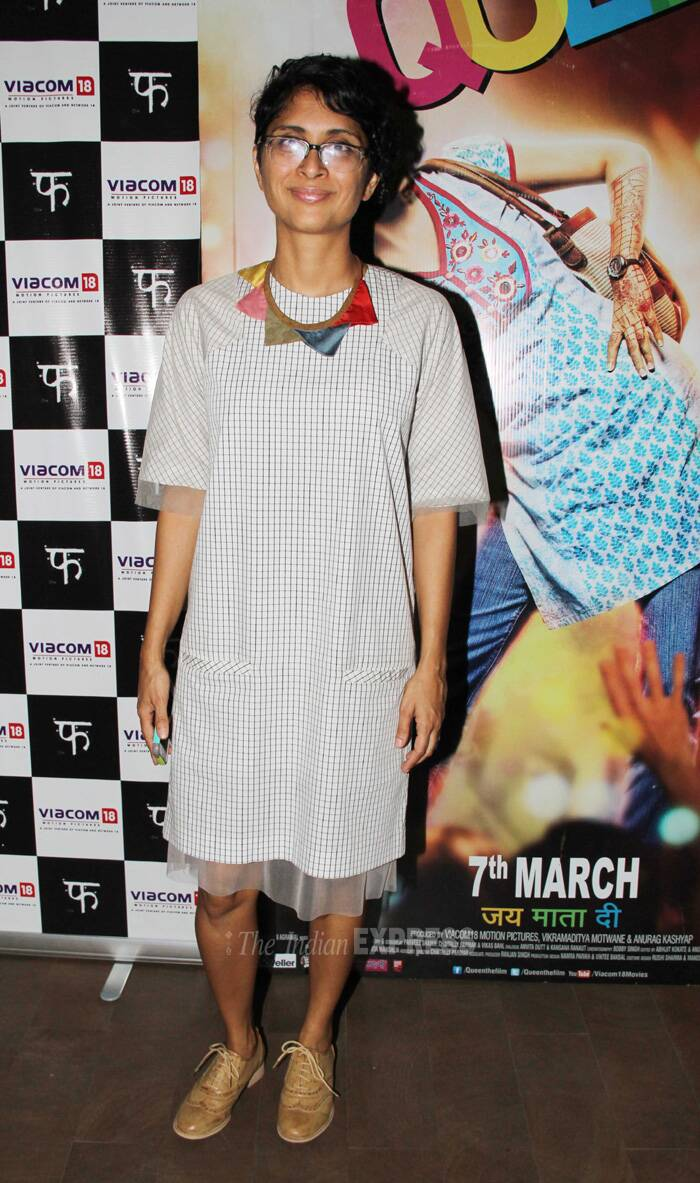 The duo were also accompanied by Aamir's filmmaker wife Kiran Rao. <br /> Kiran was passable in a check maxi. She accesorised her look with a colourful clunky neck piece that did not help up her over look. (Photo: Varinder Chawla)