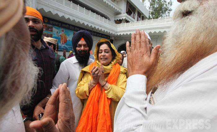 The BJP candidate, who received a less than warm welcome in the city, was accompanied by party members for the visit. (IE Photo: Jasbir Malhi)