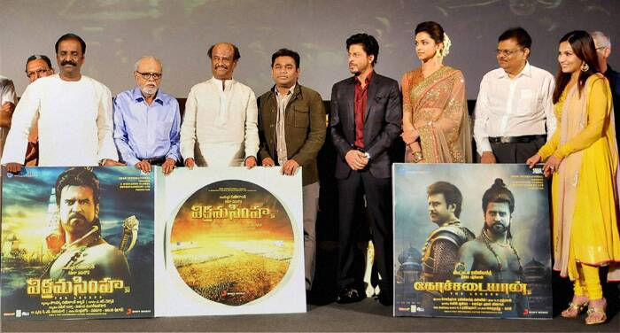 Bollywood superstar Shah Rukh Khan attended the music launch of Tamil superstar aka Thalaivaa Rajinikanth's upcoming epic drama 'Kochadaiiyaan' on Sunday (March 9) in Chennai.<br />Film's leading lady Deepika Padukone was also seen with music maestro AR Rahman at the music launch. (PTI)
