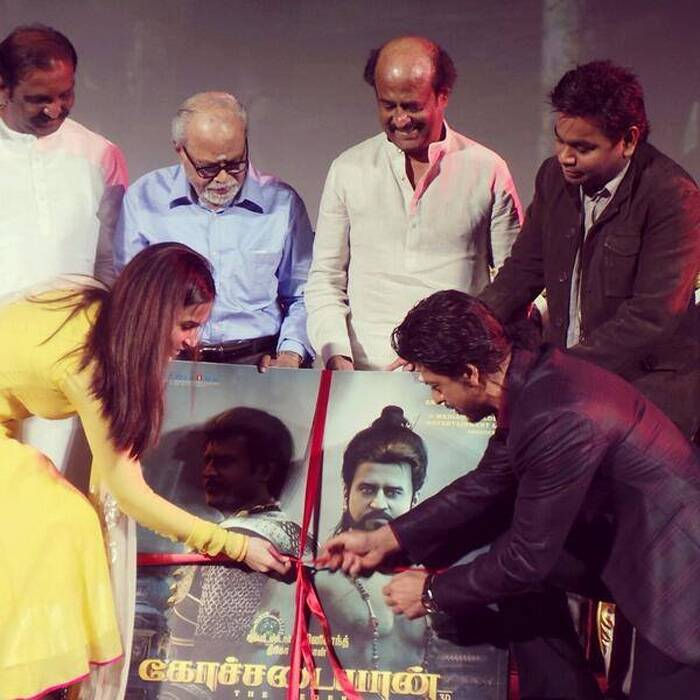 Shah Rukh Khan releases the music of 'Kochadaiiyaan' with film's director and Rajinikanth's younger daughter Soundarya R Ashwin. (Photo: Facebook)