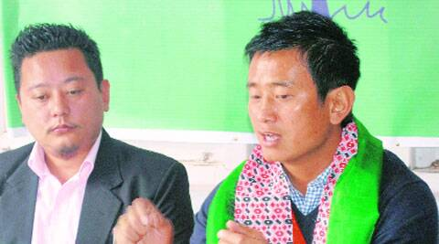 TMC candidate from Darjeeling Baichung Bhutia addresses a press conference in Gangtok, on Monday. Tshering Lepcha, General Secretary of TMC's Sikkim unit looks on.PTI