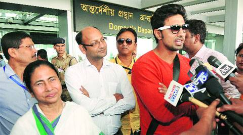 Chief Minister Mamata Banerjee and actor Deb, TMC candidate for Lok Sabha polls, talk to press outside Dum Dum Airport on Tuesday. Express
