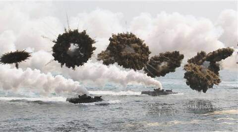 South Korean marine LVT-7 landing craft sail to shores through smoke screens during the U.S.-South Korea joint military exercises called Ssangyong, part of the Foal Eagle military exercises, in Pohang, South Korea.