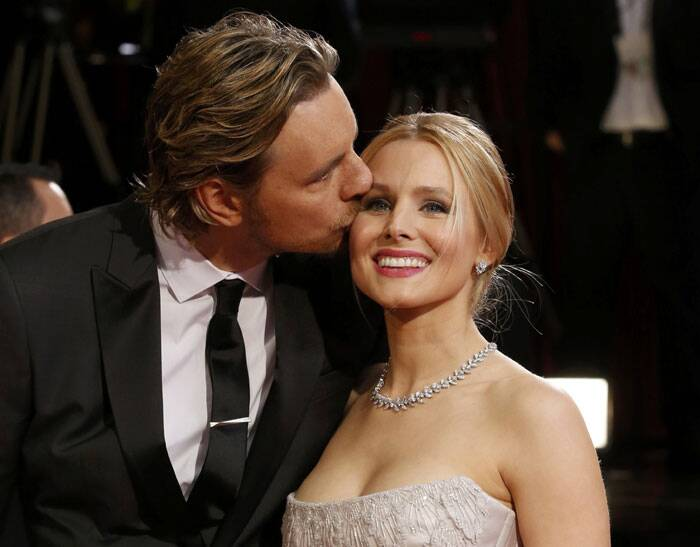 Kristen Bell gets an affectionate kiss from husband Dax Shepherd.