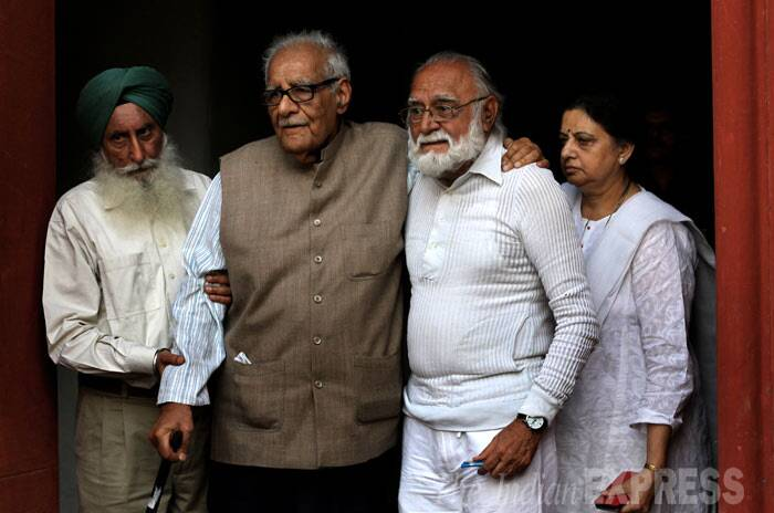 Kuldeep Nair with Khushwant Singh's son Rahul after pay tribute to renowned writer and journalist Khushwant Singh body at his residence. (IE Photo: Ravi Kanojia)
