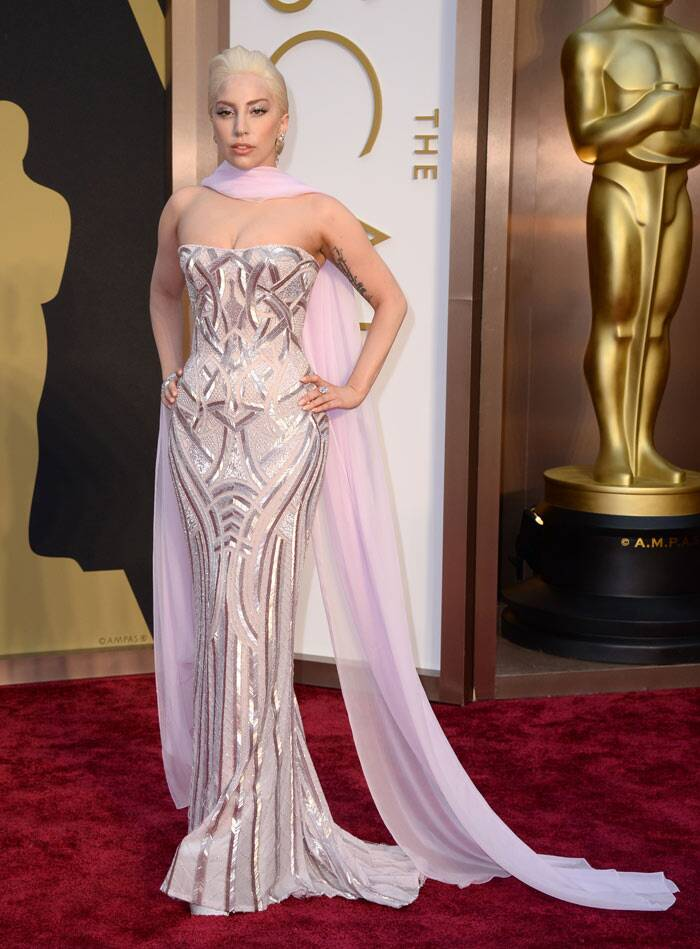 Lady Gaga was a metallic Goddess on the red carpet in a pale pink strapless Versace gown with Lorraine Schwartz diamonds. (AP)