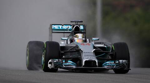 Mercedes driver Lewis Hamilton steers his car during the qualifying session for Sunday's Malaysian Formula One Grand Prix. (AP)