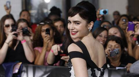 Lily Collins: Look, women go through worse things. Waxing hurts more than tattoos. (Reuters)