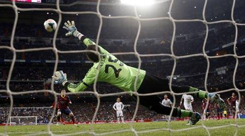 Barcelona's Lionel Messi scores a penalty goal against Real Madrid (Reuters)