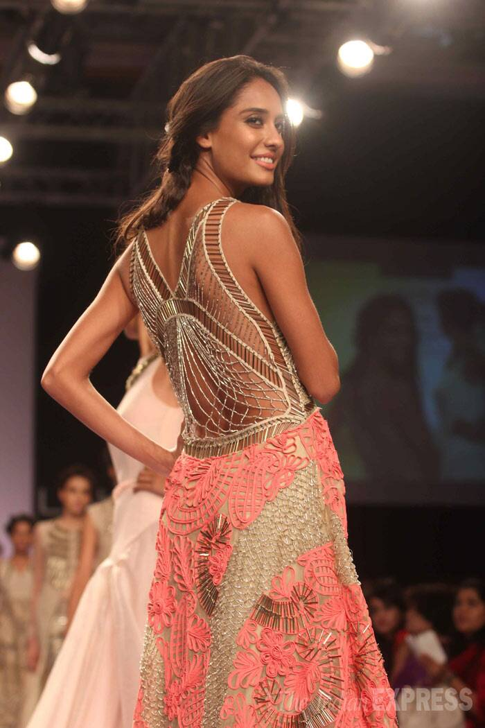 Lisa twirls around to show off the intricate pattern on the back of the creation. (Photo: Varinder Chawla)