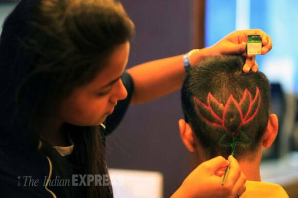 Political fever grips India, people get hair cuts of party symbols