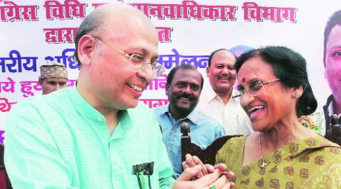Congress leader Abhishek Manu Singhvi with the party's Lucknow candidate, Rita bahuguna Joshi, at the state's party head office, in Lucknow on Saturday.  Vishal Srivastav