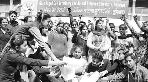 Students protest outside GADVASU in Ludhiana. (IE Photo: Gurmeet Singh)
