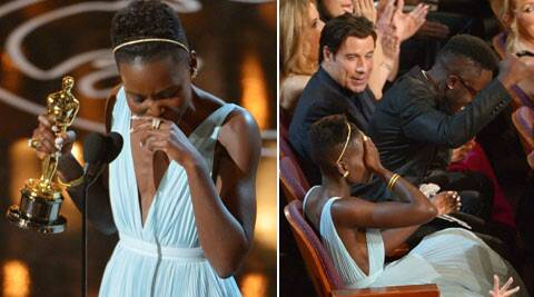When Nyong'o's name was called, the stars cheered, as did the other backstage workers. (AP)