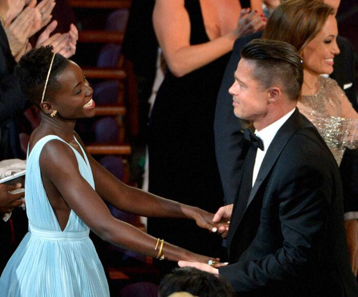 Brad Pitt shares a moment with his '12 Years a Slave' co-star Lupita Nyong'o.